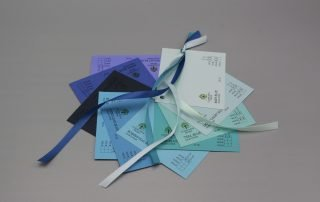 Image of Satin Ribbon on Blue Cardstock