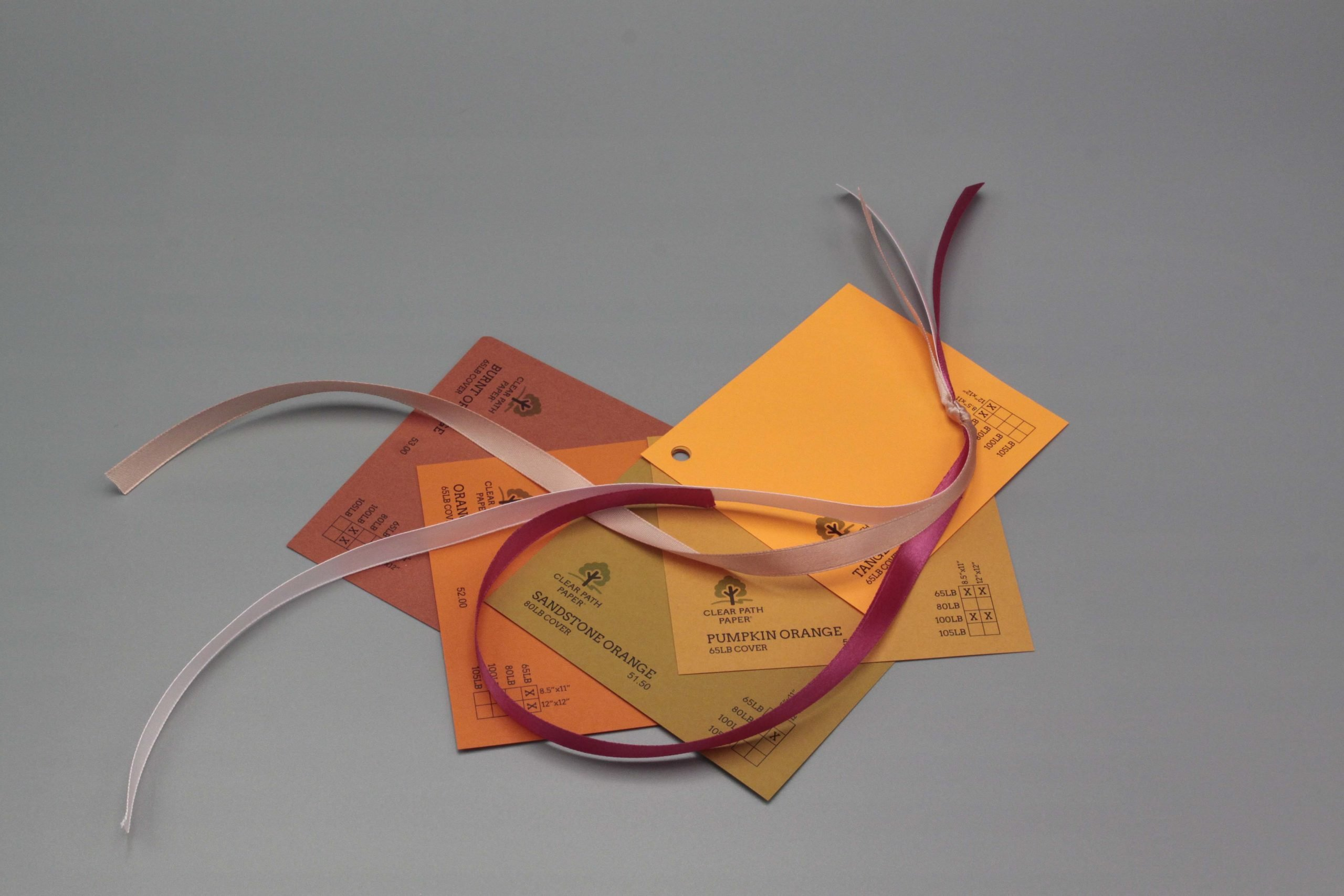 Image of Satin Ribbon on Orange Cardstock
