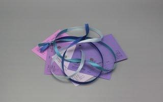Image of Satin Ribbon on Purple Cardstock