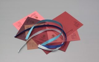 Image of Blue Satin Ribbon on Red Cardstock