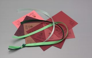 Image of Green Satin Ribbon on Red Cardstock