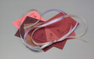 Image of Purple Satin Ribbon on Red Cardstock