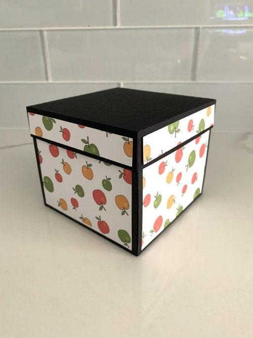 Image of a Teacher Appreciation Exploding Box covered in a cartoon apple print.