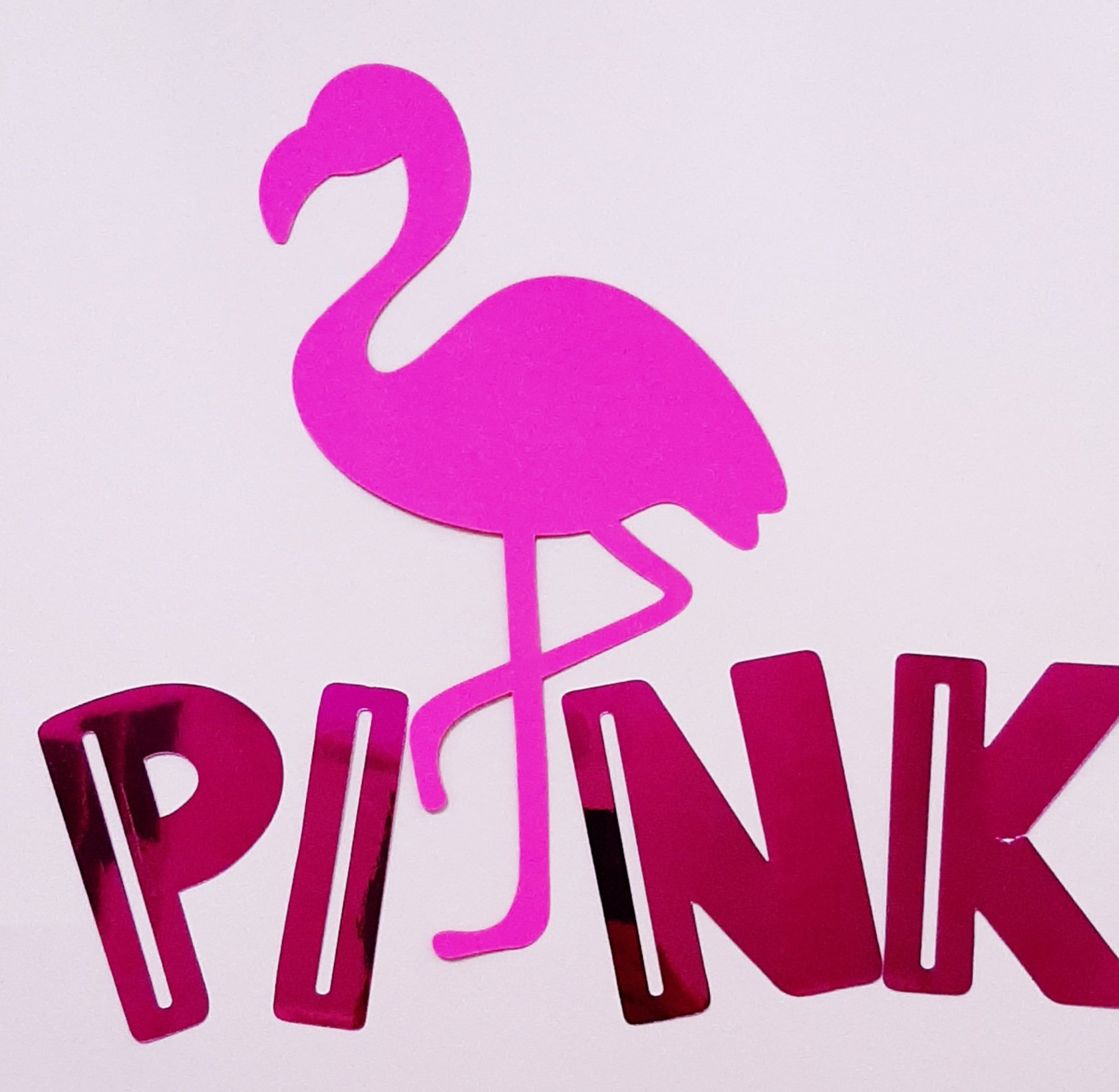 Image of a pink flamingo and pink letters spelling the word PINK