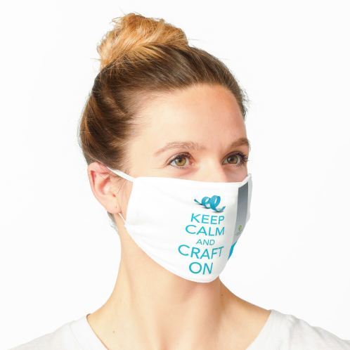 """Image of a woman wearing a face mask that has the phrase """"KEEP CALM AND CARRY ON"""" printed on it in Clear Path Paper Blue"""