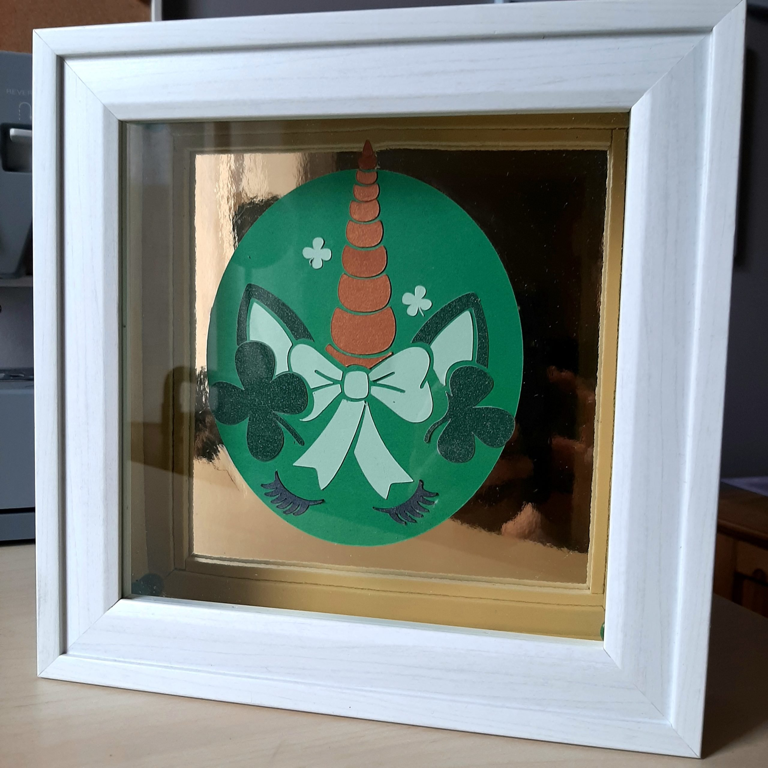 Image of a St. Patrick's Day unicorn shadow box made with Clear Path Paper cardstock.
