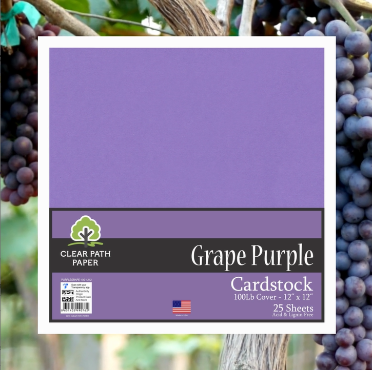 Image of a pack of Clear Path Paper Grape Purple cardstock over a photo of purple grapes