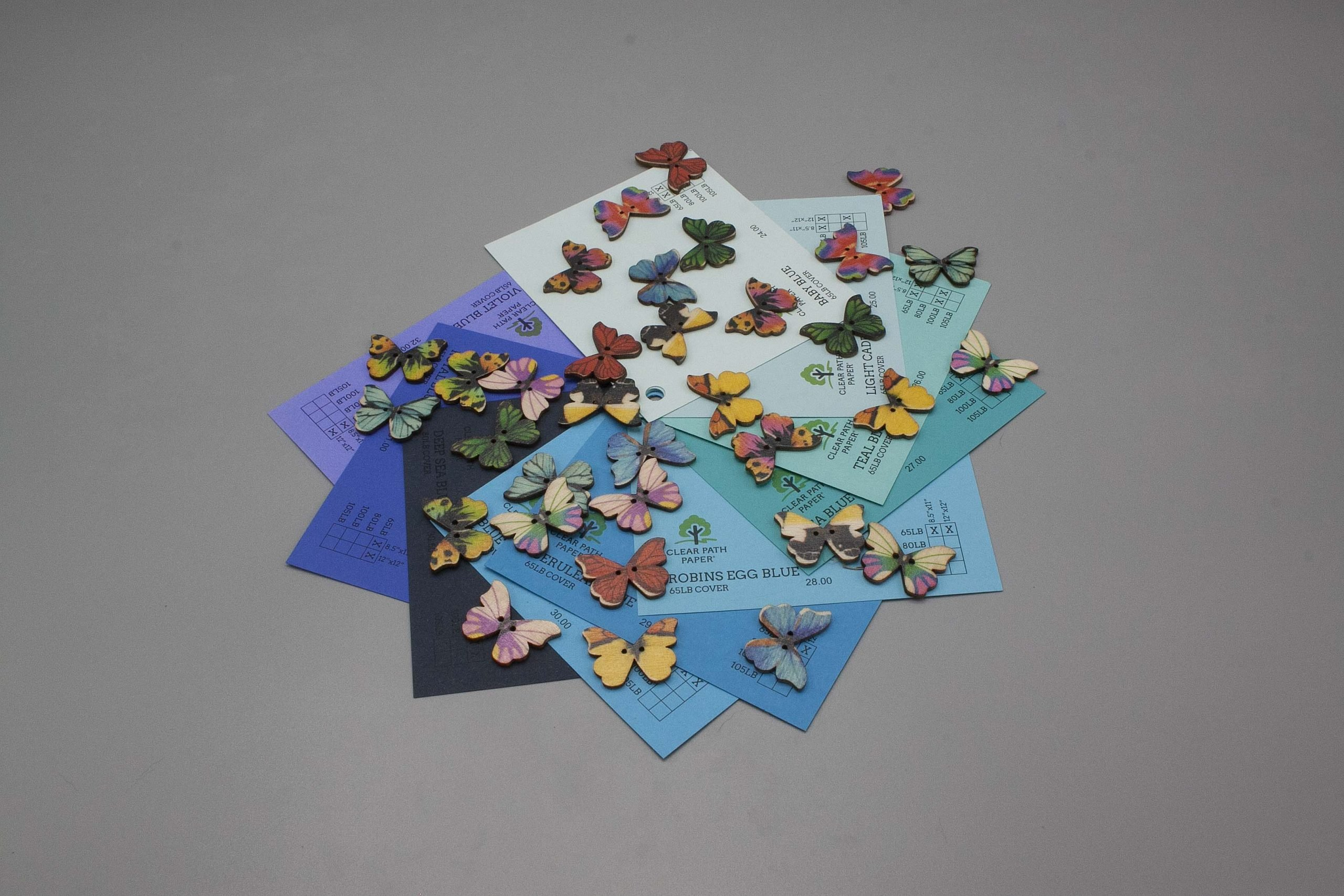 Image of Easy 99 Butterfly Buttons with blue cardstock