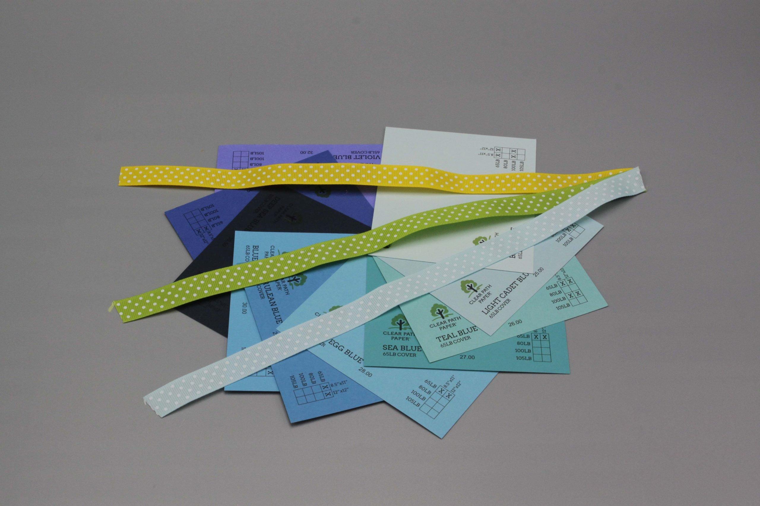 Image of Polka Dot Ribbon on Blue Cardstock