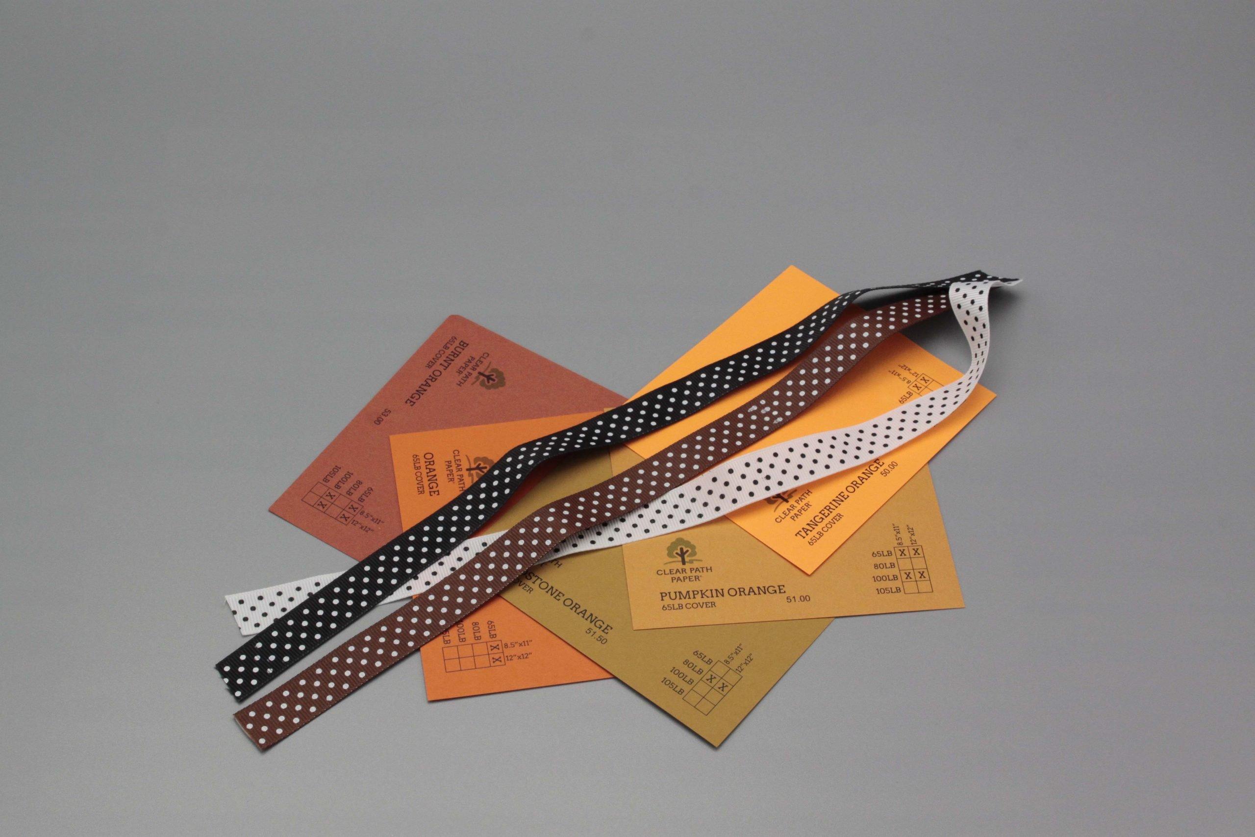 Image of Polka Dot Ribbon on Orange Cardstock