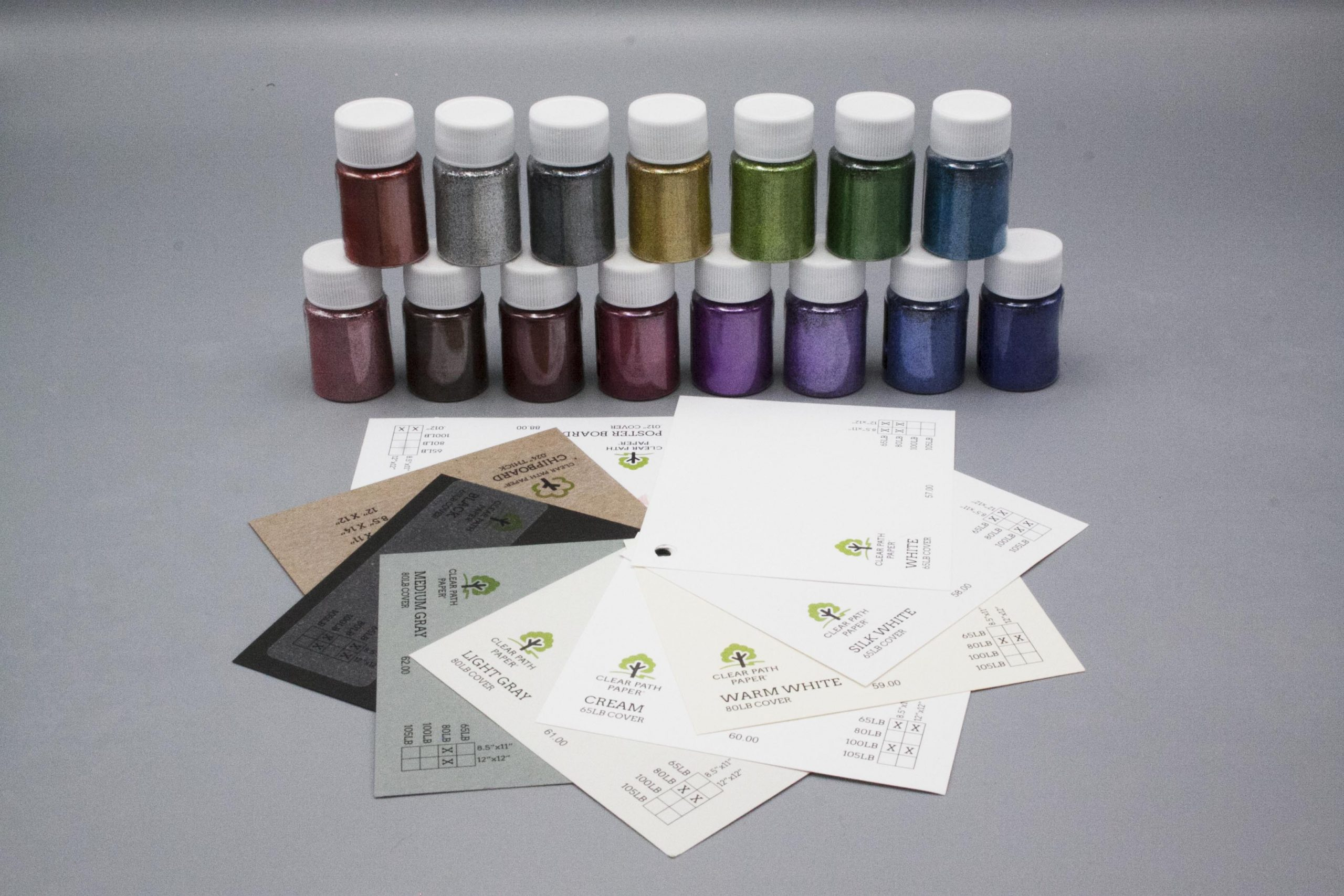 Image of LETS RESIN Glitter Powder with Black, Gray, and White Cardstock